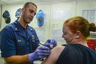 A sailor receives a flu shot. Credit: US Navy